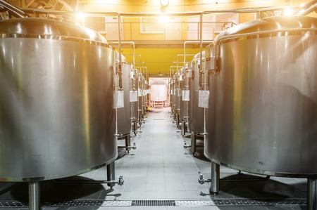 Modern Beer Factory. Rows of steel tanks for the storage beer. Stock Photo