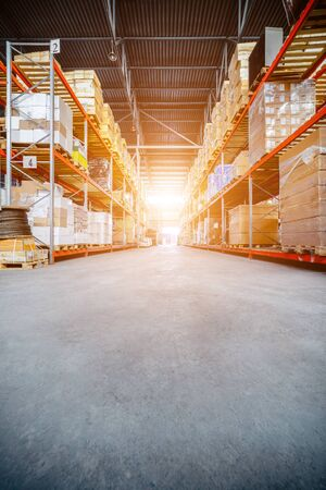 sinlight: Long shelves with a variety of boxes and containers. Stock Photo