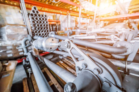 Various mechanisms and gray metal pipe. Stock Photo