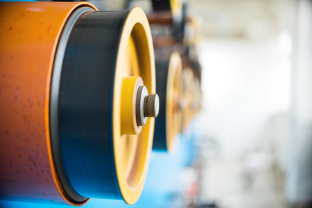 trundle: Rotating rubberized wheels of the winding machine.