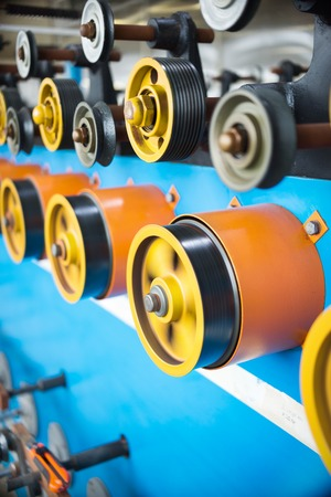 Drive wheels and auxiliary rollers of an automatic winding machine. Stock Photo