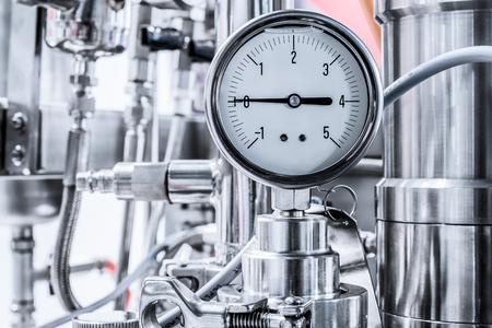 Hydraulic fluid pressure indicator, arrow indicates zero. Stock Photo