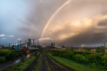 LIPETSK, RUSSIA - JUNE , 2017: Metallurgical plant NLMK Group. A colored rainbow above the metallurgical plant.