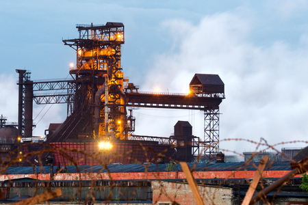 LIPETSK, RUSSIA - JUNE , 2017: Metallurgical plant NLMK Group. Blast furnace, iron production, metallurgical production Night Snapshot