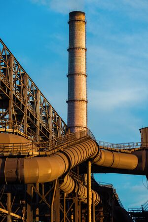 LIPETSK, RUSSIA - JUNE , 2017: Metallurgical plant NLMK Group. Large rusty flues metallurgical enterprise Industrial architecture Редакционное
