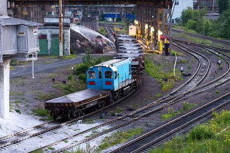 LIPETSK, RUSSIA - JUNE , 2017: Metallurgical plant NLMK Group. Freight railroad train with bowls of molten metallurgical slag. Factory slag. Редакционное