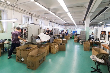 blanks: MOSCOW, RUSSIA - FEBRUARY 21, 2017: Moscow shoe factory JSC RALF RINGER. Shop processing of leather blanks. Editorial