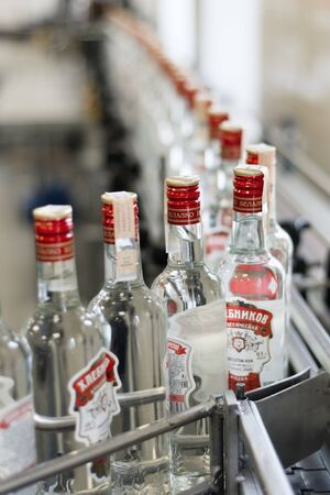 Brest Distillery. The conveyor with bottles of vodka. Editorial