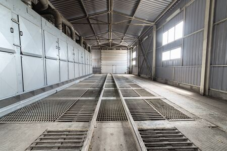 premises: A large hangar with a floor made of steel gratings.