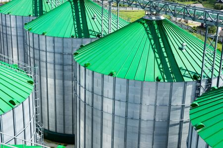 Silos for storage of grain, silo roof close-up. Warehouse of wheat and other cereals. Stock Photo