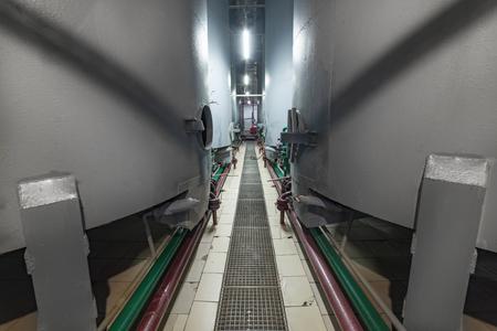 Steel gray tanks for yeast fermentation. Stock Photo