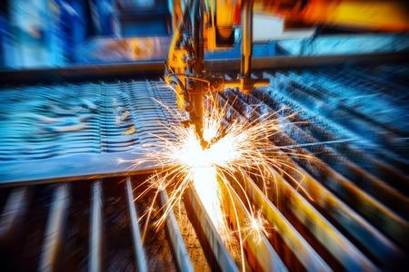 Oxygen torch cuts steel sheet.