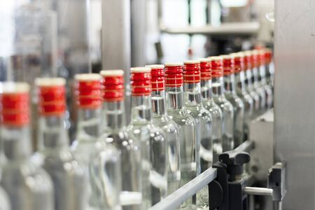 Bottles with vodka on the conveyor.