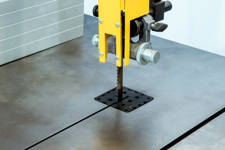 Working table of a vertical band saw.