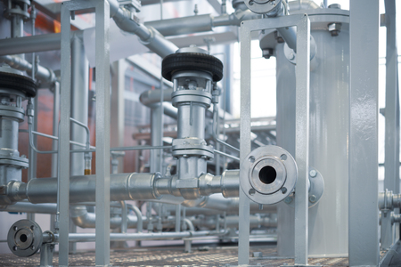 System of industrial cryogenic pipelines. A lot of pipes, flanges and valves. Standard-Bild
