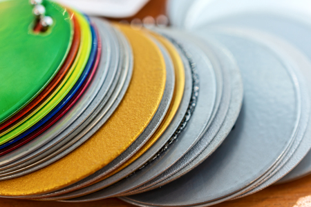 Round metal plates, painted in various colors.