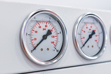 Three gauge on the dashboard of industrial compressor. Banco de Imagens