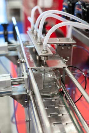 Automatic machine for filling and capping bottles.