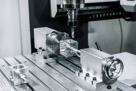 Precision milling CNC machine tool makes part.