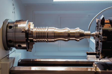 Machining of parts on a lathe.