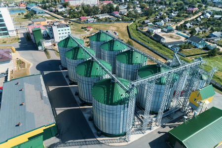The modern granary. Metal silos with green roofs. 版權商用圖片