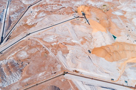 Huge mounds of unused rock. The system of long belt conveyors.