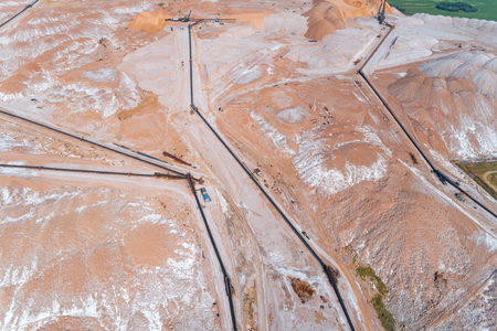 Huge mounds of unused rock. The system of long belt conveyors