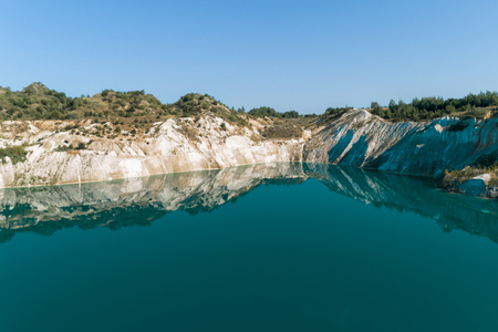 An old gypsum quarry filled with blue and pure water. Aerial view, from top to bottom 版權商用圖片