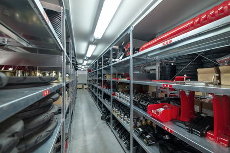 Factory warehouse spare parts. Storage and distribution of components Фото со стока