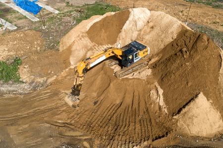 Crawler excavator while working. Producing earthworks.