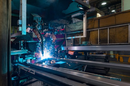 The welding robot does the welding of metal spars
