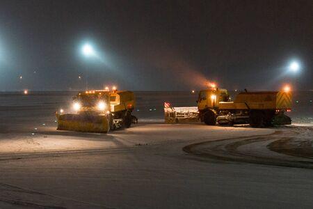 MOSCOW, RUSSIA. Vnukovo international airport 12.26.2018 Snow machines during operation Night shot