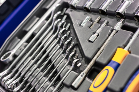 A set of wrenches in a plastic box. A set for car repair. Close-up photo.