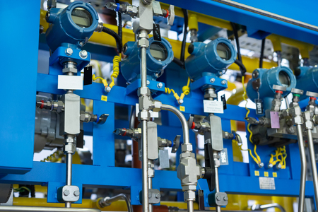 Complex control system of gas equipment. Many pipelines, sensors and digital pressure gauges Stock Photo
