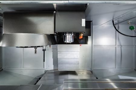Work space of modern CNC milling machine.