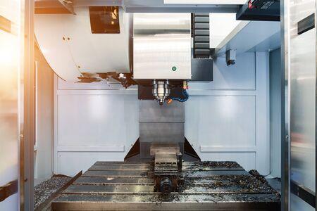 Working area of modern CNC milling machine Фото со стока