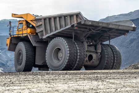 Rock transportation by dump trucks. Stockfoto