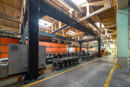 Roller forming machine. The interior of the plant producing a metal profile.