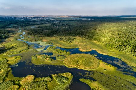 Beautiful aerial shot of a large forest lake.