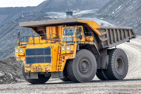 Quarry truck carries coal mined.