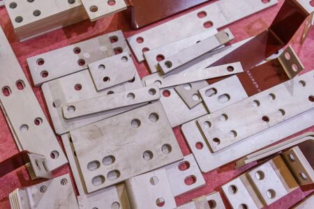 Rectangular metal plates with round holes.