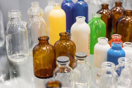 Many glass and plastic bottles. Bottles for chemicals, medicines and pharmaceuticals.
