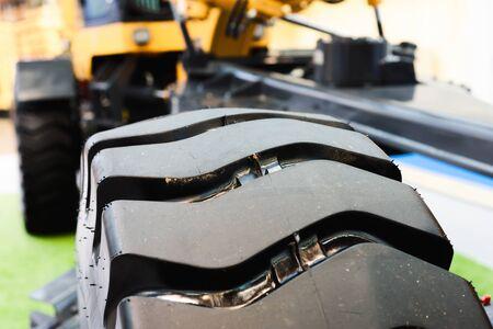 Tractor wheel. Part of the wheel tread closeup.
