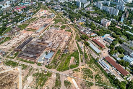 Demolition work of a large old factory. Dismantling on the territory of a big city. aerial view