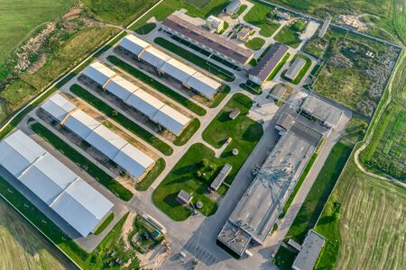 Agricultural plant in the middle of boundless agricultural land. A modern enterprise for the production of various livestock products.