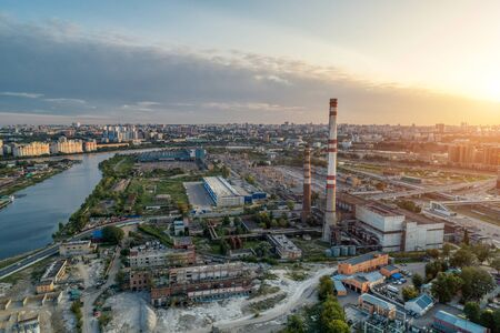 Inactive thermal power station located in the middle of a big city. Aerial view. Stock Photo