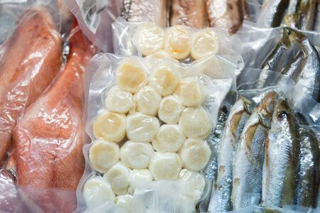 Frozen fish in a commercial freezer. Different river fish, fish cakes, sea bass