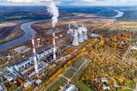 State District Power Station generating heat and electricity. High pipes and cooling towers are visible. Aerial view. Autumn landscape.