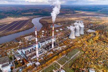 An energy station that generates heat and electric energy for heating and lighting urban homes. Aerial view. Autumn landscape. Banco de Imagens