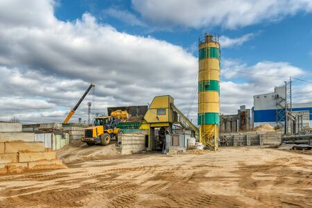 Concrete mixing plant. Visible are the towers for cement storage, the building of the concrete mixing machine and the loading ramp and silos for inert materials.